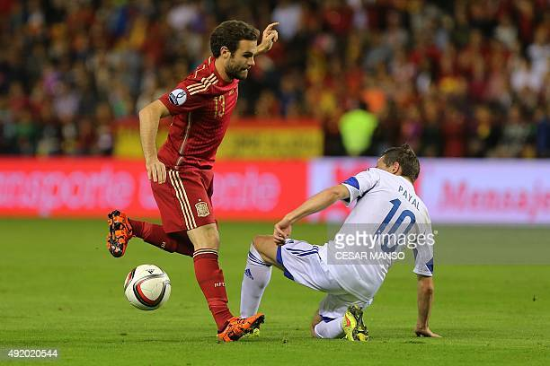 Spain's midfielder Juan Mata vies with Luxembourg's midfielder Ben Payal during the Euro 2016 qualifying football match Spain vs Luxembourg at Las...