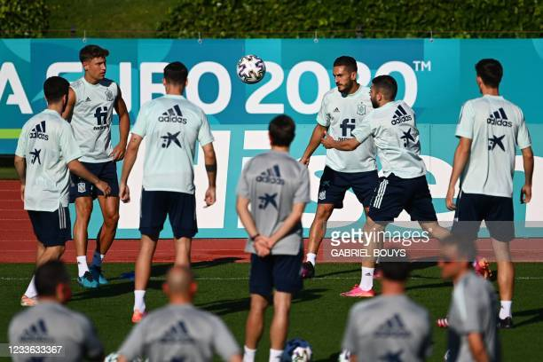 Spain's midfielder Koke and teammates attend a training session at Ciudad del Futbol in Las Rozas de Madrid on June 24, 2021 as part of the UEFA EURO...