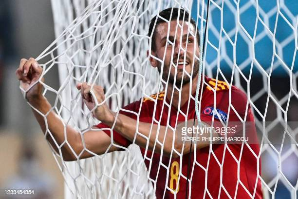 Spain's midfielder Koke gestures in the net during the UEFA EURO 2020 Group E football match between Spain and Sweden at La Cartuja Stadium in...