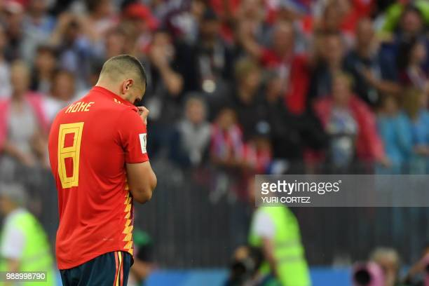 Spain's midfielder Koke reacts after missing his penalty during the penalty shootout in the Russia 2018 World Cup round of 16 football match between...