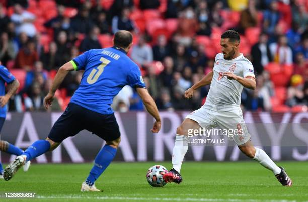 Spain's midfielder Koke runs with the ball during the UEFA EURO 2020 semi-final football match between Italy and Spain at Wembley Stadium in London...