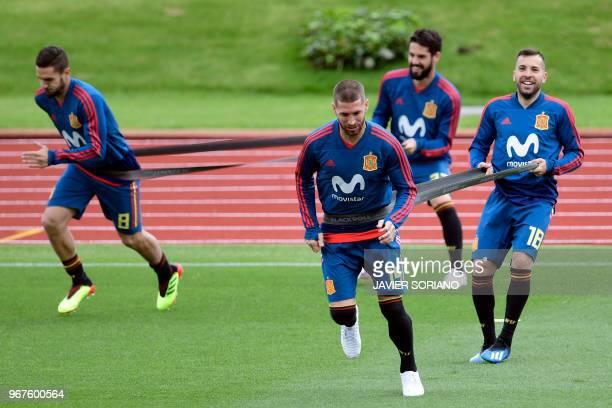 Spain's midfielder Koke Spain's defender Sergio Ramos Spain's midfielder Isco and Spain's defender Jordi Alba attend a training session at Las Rozas...