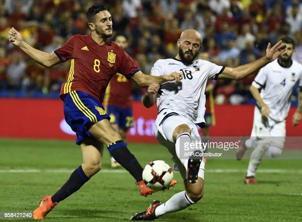 Spain's midfielder Koke vies with Albania's defender Arlind Ajeti during the World Cup 2018 qualifier football match Spain vs Albania at the Jose...