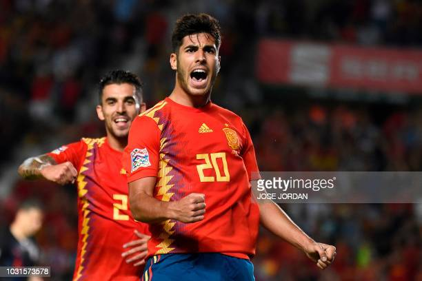 TOPSHOT Spain's midfielder Marco Asensio celebrates with Spain's midfielder Dani Ceballos after scoring a goal during the UEFA Nations League A group...