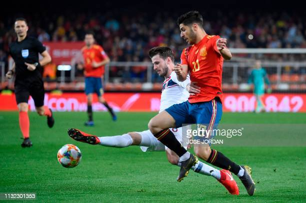 Spain's midfielder Marco Asensio challenges Norway's defender Havard Nordtveit during the Euro 2020 group F qualifying football match between Spain...