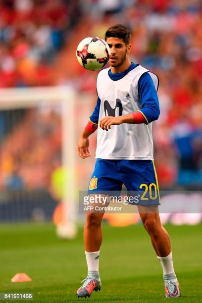Spain's midfielder Marco Asensio eyes the ball before the World Cup 2018 qualifier football match Spain vs Italy at the Santiago Bernabeu stadium in...