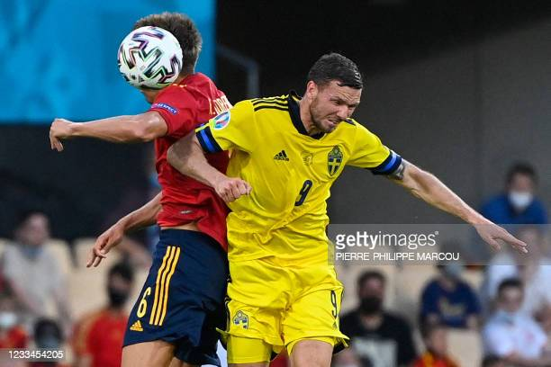 Spain's midfielder Marcos Llorente heads the ball with Sweden's forward Marcus Berg during the UEFA EURO 2020 Group E football match between Spain...