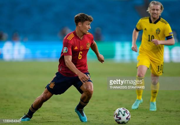 Spain's midfielder Marcos Llorente looks for a pass during the UEFA EURO 2020 Group E football match between Spain and Sweden at La Cartuja Stadium...