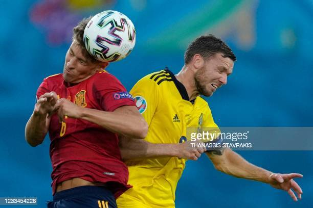 Spain's midfielder Marcos Llorente vies for the header with Sweden's forward Marcus Berg during the UEFA EURO 2020 Group E football match between...