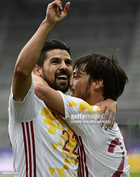 Spain's midfielder Nolita celebrates after winning the friendly football match Spain versus Bosnia at the AFG Arena in St Gallen on May 29 2016 in...