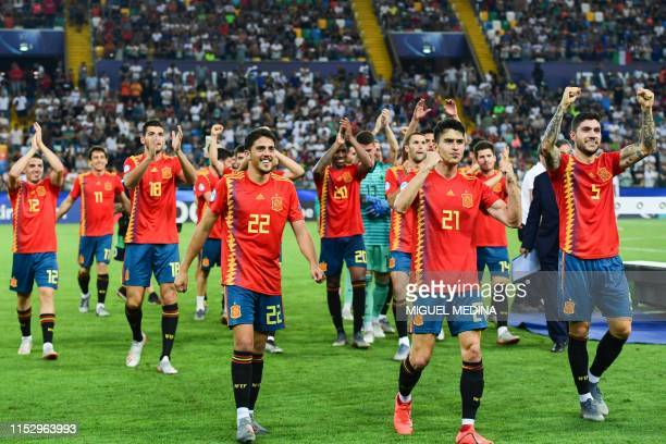 Spain's midfielder Pablo Fornals, Spain's defender Marc Roca and Spain's defender Unai Nunez and teammates celebrate after winning the final match of...