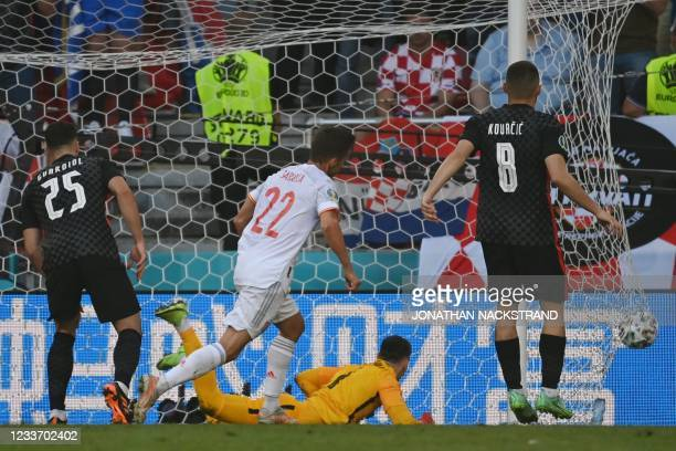 Spain's midfielder Pablo Sarabia celebrates after scoring Spain's first goal during the UEFA EURO 2020 round of 16 football match between Croatia and...