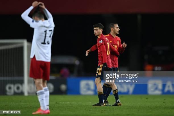 Spain's midfielder Pedri and Spain's midfielder Thiago Alcantara celebrate after the FIFA World Cup Qatar 2022 qualification football match Georgia v...