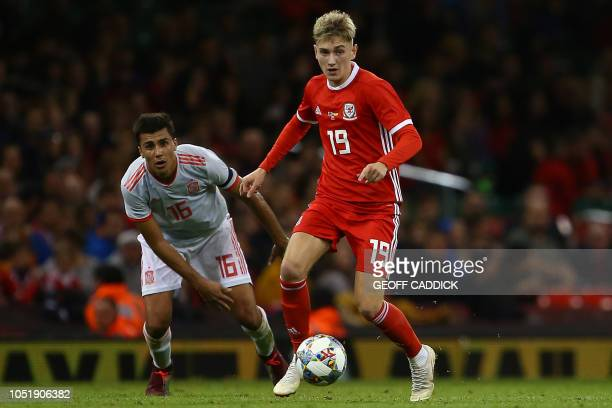 Spain's midfielder Rodri vies with Wales' striker David Brooks during the international friendly football match between Wales and Spain at The...