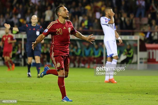 Spain's midfielder Santi Cazorla celebrates after scoring during the Euro 2016 qualifying football match Spain vs Luxembourg at Las Gaunas stadium in...
