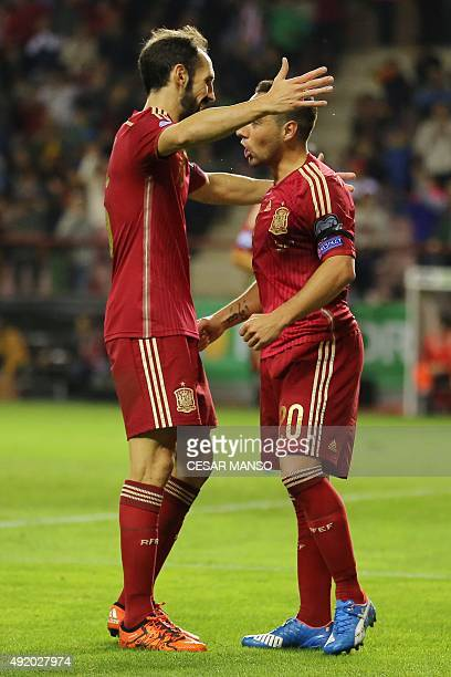 Spain's midfielder Santi Cazorla celebrates with Spain's defender Juanfran during the Euro 2016 qualifying football match Spain vs Luxembourg at Las...