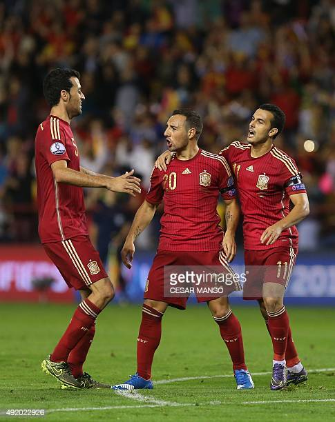 Spain's midfielder Santi Cazorla celebrates with teammates during the Euro 2016 qualifying football match Spain vs Luxembourg at Las Gaunas stadium...