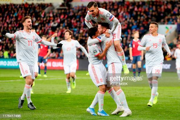 Spain's midfielder Saul Niguez celebrates scoring the opening goal with his teammates during the Euro 2020 qualifying football match Norway v Spain...