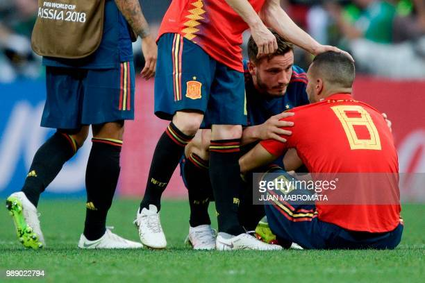 Spain's midfielder Saul Niguez talks with Spain's midfielder Koke after loosing the penalty shootout at the end of the Russia 2018 World Cup round of...
