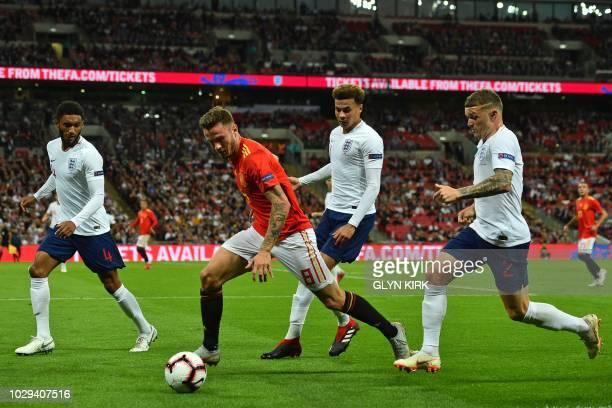 Spain's midfielder Saul Niguez vies with England's defender Joe Gomez England's midfielder Dele Alli and England's defender Kieran Trippier during...