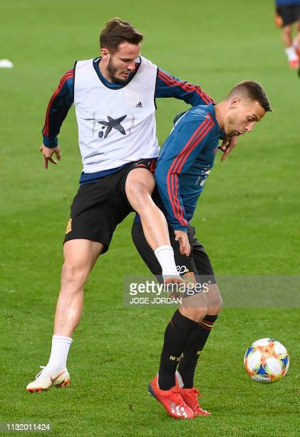 Spain's midfielder Saul Niguez vies with Spain's midfielder Sergio Canales during a training session at the Mestalla stadium in Valencia on March 22...