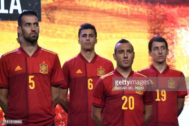 Spain's midfielder Sergio Busquets and Spain's midfielder Santi Cazorla pose during the presentation of Spain's new jersey for the UEFA Euro 2020...