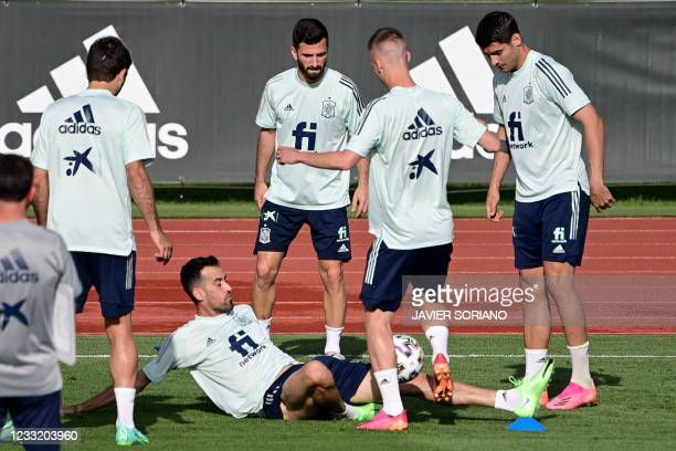Spain's midfielder Sergio Busquets and teammates attend Spain's national football team's first training session on May 31, 2021 at the Ciudad del...