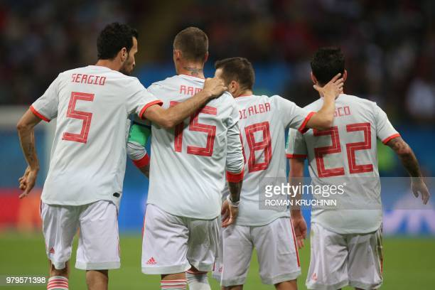Spain's midfielder Sergio Busquets, defender Sergio Ramos, defender Jordi Alba and midfielder Isco celebrate a goal during the Russia 2018 World Cup...
