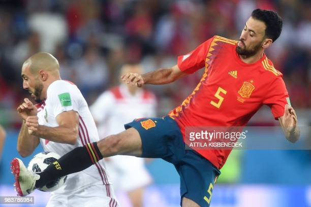 Spain's midfielder Sergio Busquets vies with Morocco's forward Noureddine Amrabat during the Russia 2018 World Cup Group B football match between...