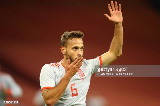 Spain's midfielder Sergio Canales celebrates scoring his team's first goal during the friendly football match between Netherlands and Spain at the...