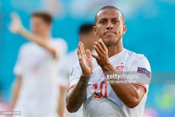 Spain's midfielder Thiago Alcantara applauds after the UEFA EURO 2020 Group E football match between Slovakia and Spain at La Cartuja Stadium in...
