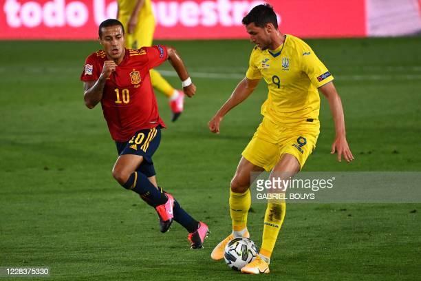 Spain's midfielder Thiago Alcantara challenges Ukraine's forward Roman Yaremchuk during the UEFA Nations League A group 4 football match between...