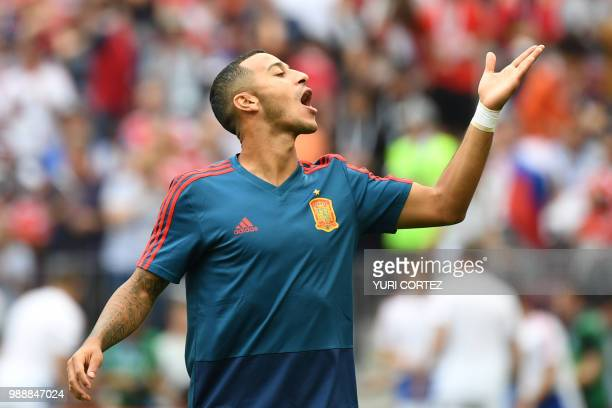Spain's midfielder Thiago Alcantara gestures during the warm-up before the Russia 2018 World Cup round of 16 football match between Spain and Russia...