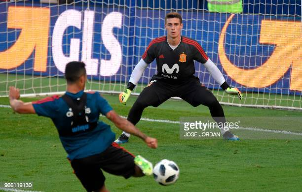 Spain's midfielder Thiago Alcantara shoots in front of Spain's goalkeeper Kepa Arrizabalaga attends a training session of Spain's national football...