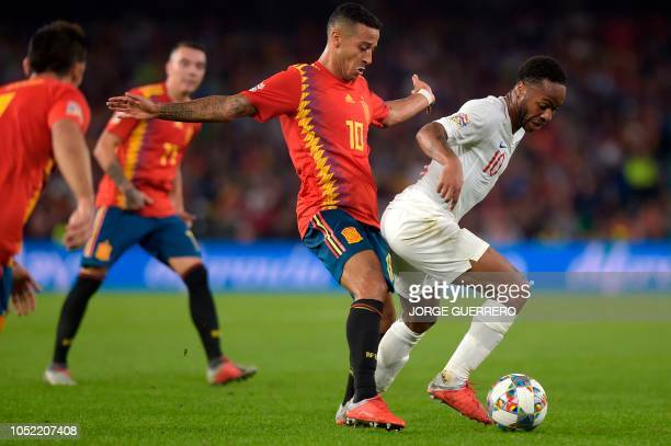 Spain's midfielder Thiago Alcantara vies with England's forward Raheem Sterling during the UEFA Nations League football match between Spain and...