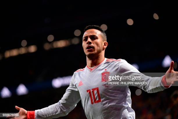 Spain's midfielder Thiago celebrates after scoring his team's fourth goal during a friendly football match between Spain and Argentina at the Wanda...