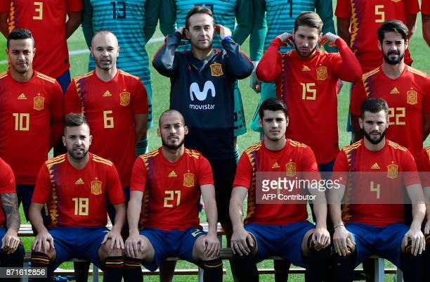 Spain's midfielder Thiago Spain's midfielder Andres Iniesta Spain's coach Julen Lopetegui Spain's defender Sergio Ramos Spain's midfielder Isco...