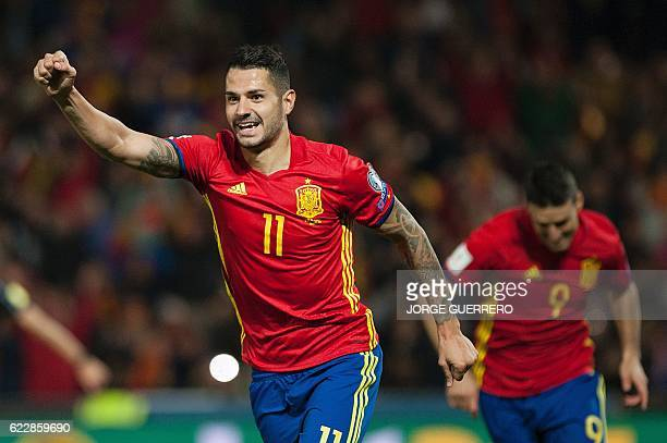 Spain's midfielder Vitolo celebrates after scoring during the FIFA qualifying Group G football match Spain vs Macedonia at Los Carmenes stadium in...