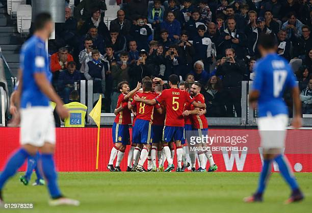 Spain's midfielder Vitolo celebrates with teammates after scoring during the WC 2018 football qualification match between Italy and Spain on October...