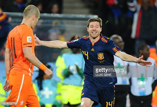 Spain's midfielder Xabi Alonso celebrates after his team won the 2010 World Cup football final Netherlands vs Spain on July 11 2010 at Soccer City...