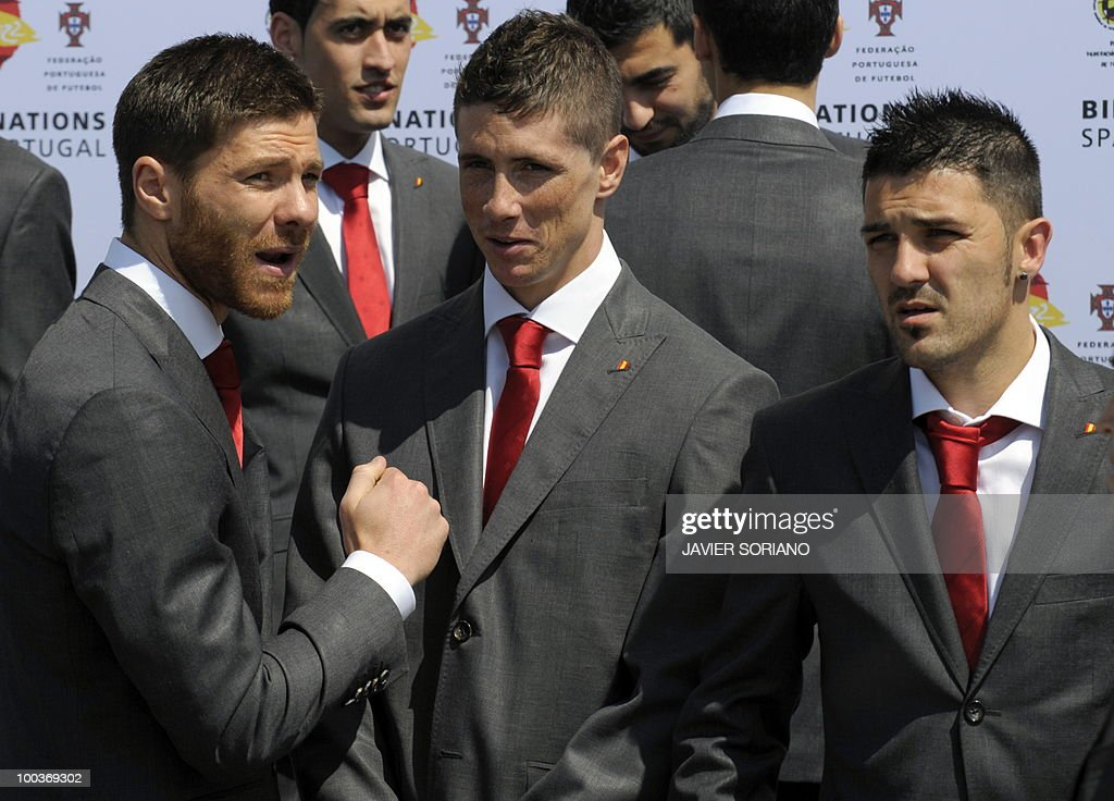 Spain's midfielder Xavi Alonso, forward Fernando Torres and forward David Villa chat before a group picture during the inauguration of RFEF museum on May 24, 2010 at the Sports City of Las Rozas, near Madrid. Spain, among the favourites for the World Cup, which runs from June 11-July 11, face Switzerland, Honduras and Chile in Group H of the opening round.