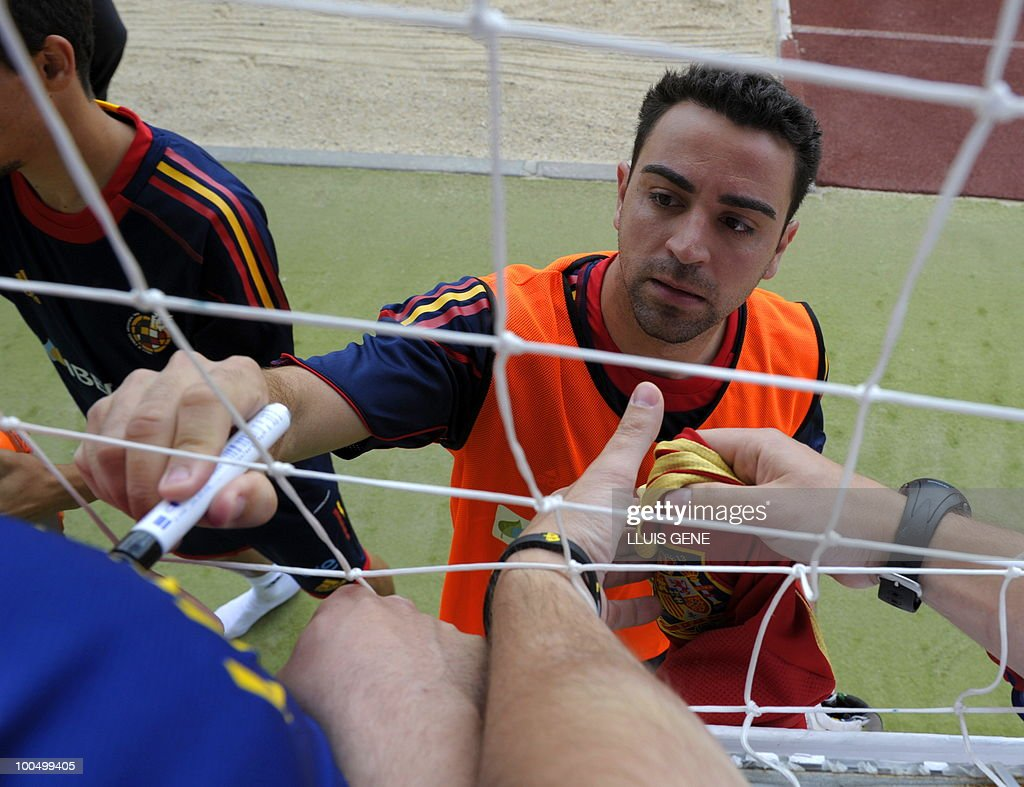 Spain's midfielder Xavi Hernandez signs autographs after a training session of the Spanish football team on May 25, 2010, at the Sports City of Las Rozas, near Madrid. Spain, among the favourites for the World Cup, which runs from June 11-July 11, face Switzerland, Honduras and Chile in Group H of the opening round.