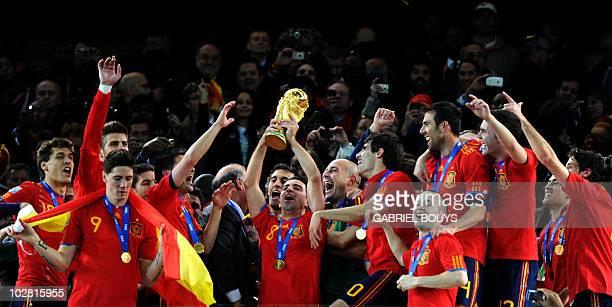 Spain's midfielder Xavi raises the trophy as Spain's national football team players celebrate winning the 2010 World Cup football final Netherlands...