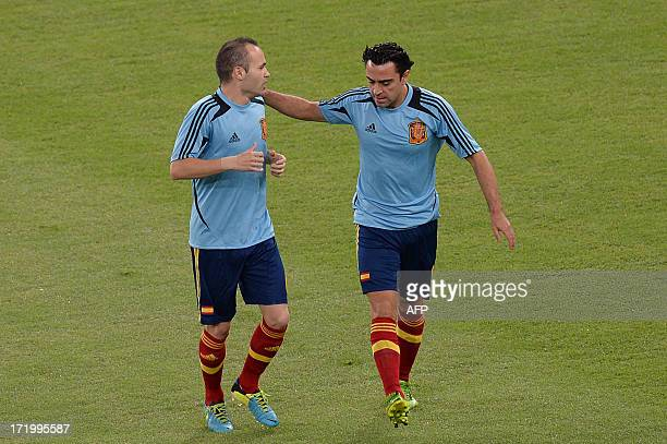 Spain's midfielders Andres Iniesta and Xavi Hernandez warm up before the start of the FIFA Confederations Cup Brazil 2013 final football match...