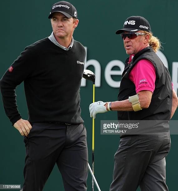 Spain's Miguel Angel Jimenez and US golfer Jimmy Walker prepare to play the first tee during the first round of the 2013 British Open Golf...