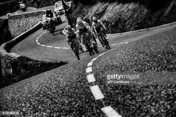 Spain's Mikel Nieve, Poland's Michal Kwiatkowski and France's Warren Barguil wearing the best climber's polka dot jersey ride in a breakaway during...