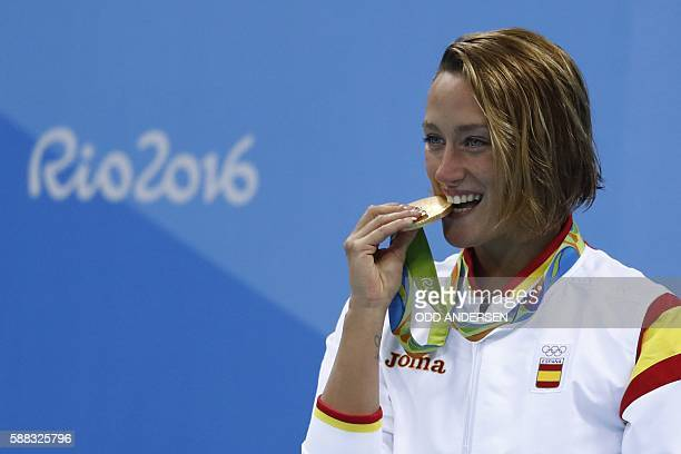 Spain's Mireia Belmonte Garcia poses with her gold medal on the podium after she won the Women's 200m Butterfly Final during the swimming event at...