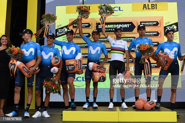 Spain's Movistar Team cycling team celebrates tehir Best Team prize on the podium of the tenth stage of the 106th edition of the Tour de France...