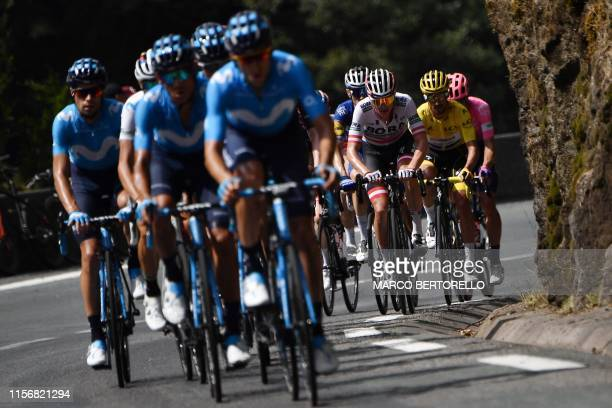 Spain's Movistar Team cycling team rides with France's Julian Alaphilippe , wearing the overall leader's yellow jersey during the fourteenth stage of...