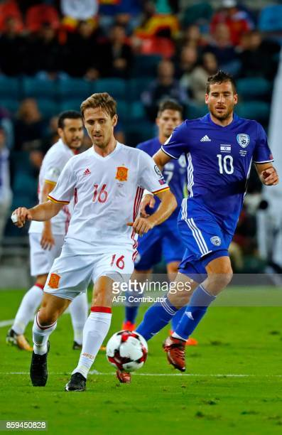 Spain's Nacho Monreal vies for the ball with Israel's forward Tomer Hemed during the Russia 2018 FIFA World Cup European Group G qualifying football...